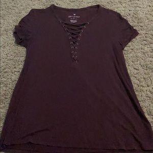 Burgundy shirt with latter affect neck line